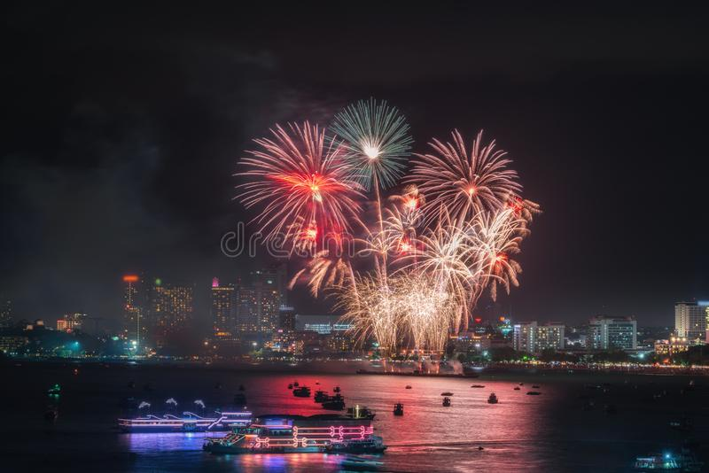 Fireworks international colorful Pattaya beach cityscape at night scene for advertise traveling event holiday., Pattaya city. Fireworks international colorful royalty free stock image