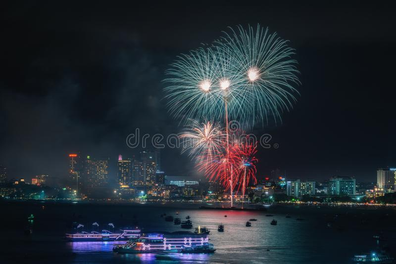 Fireworks international colorful Pattaya beach cityscape at night scene for advertise traveling event holiday. Pattaya city stock images