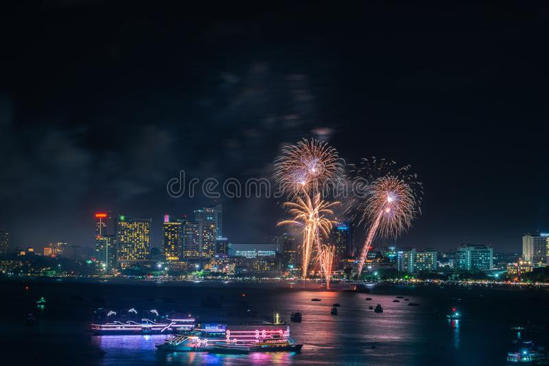 Fireworks international colorful Pattaya beach cityscape at night scene for advertise traveling event holiday., Pattaya city. Fireworks international colorful royalty free stock photography