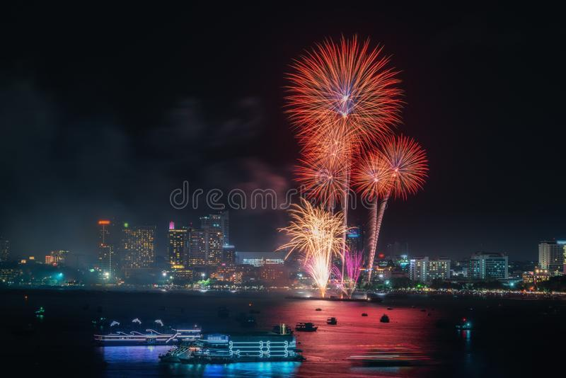 Fireworks international colorful Pattaya beach cityscape at night scene for advertise traveling event holiday. Pattaya city royalty free stock photography