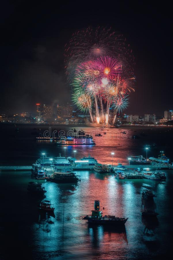 Fireworks international colorful Pattaya beach cityscape at night scene for advertise traveling event holiday. Pattaya city stock image