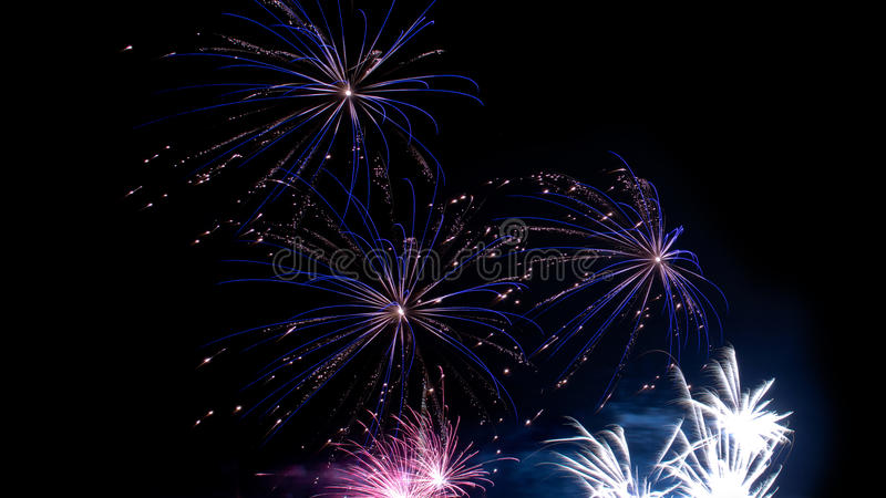 Fireworks. A landscape view of a colorful fireworks display on a dark sky background. Photo taken on December 20th, 2014 royalty free stock photo