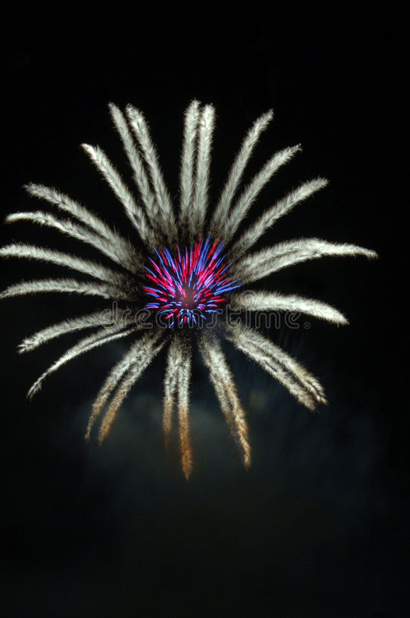 Fireworks lighting in floral pattern at night. Fireworks lighting and creating a floral pattern at night stock photography