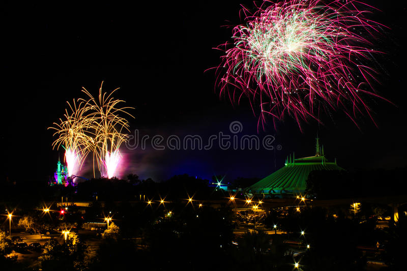 Fireworks at the Magic Kingdom. Fireworks go off behind Cinderella's Castle and Space Mountain in Orlando, Florida stock image