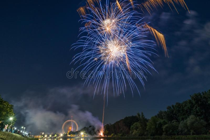 Fireworks of the Maidult with Ferris wheel in Regensburg, Germany.  royalty free stock photography