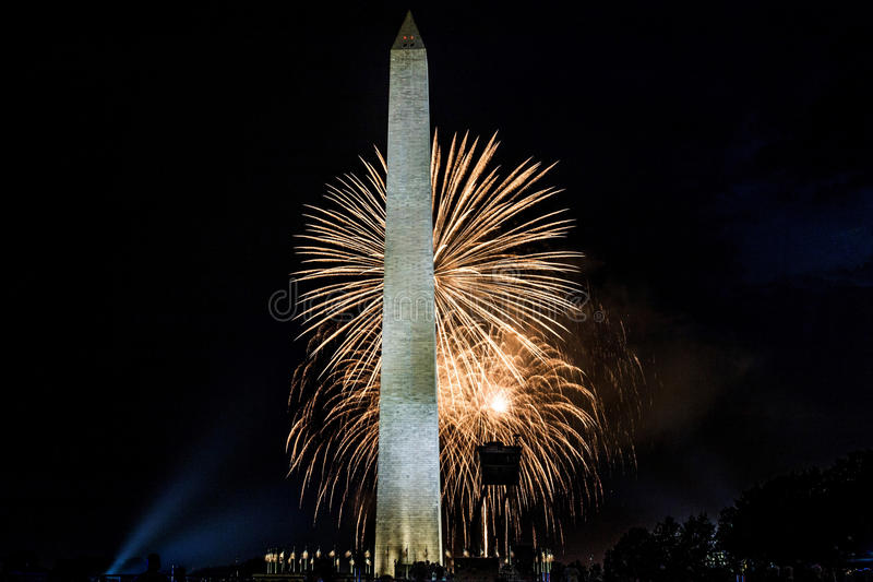 Fireworks on the mall in Washington DC on the 4th of July 2017. Bright white fireworks light up the sky with the Washington monument in view on the fourth of stock photos