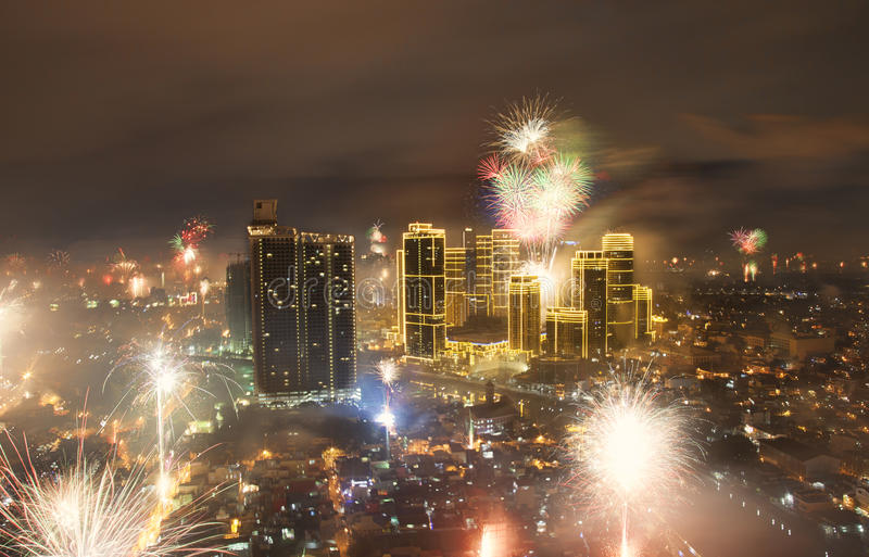 Fireworks and Manila city skyline. Manila, Philippines - 31 December 2016: New Years` Eve fireworks with Rockwell center in Makati illuminated stock image