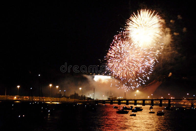 Fireworks Montmorency waterfall, Québec. Watching fireworks on Boats near the Montmorency waterfall, Québec royalty free stock image