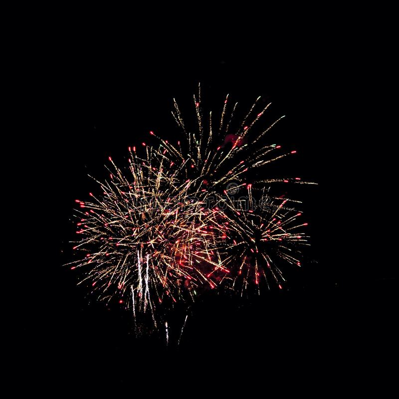 Fireworks. In the night sky. Colored lights on a black background. Celebration and joy. New year's . The fire show royalty free stock images