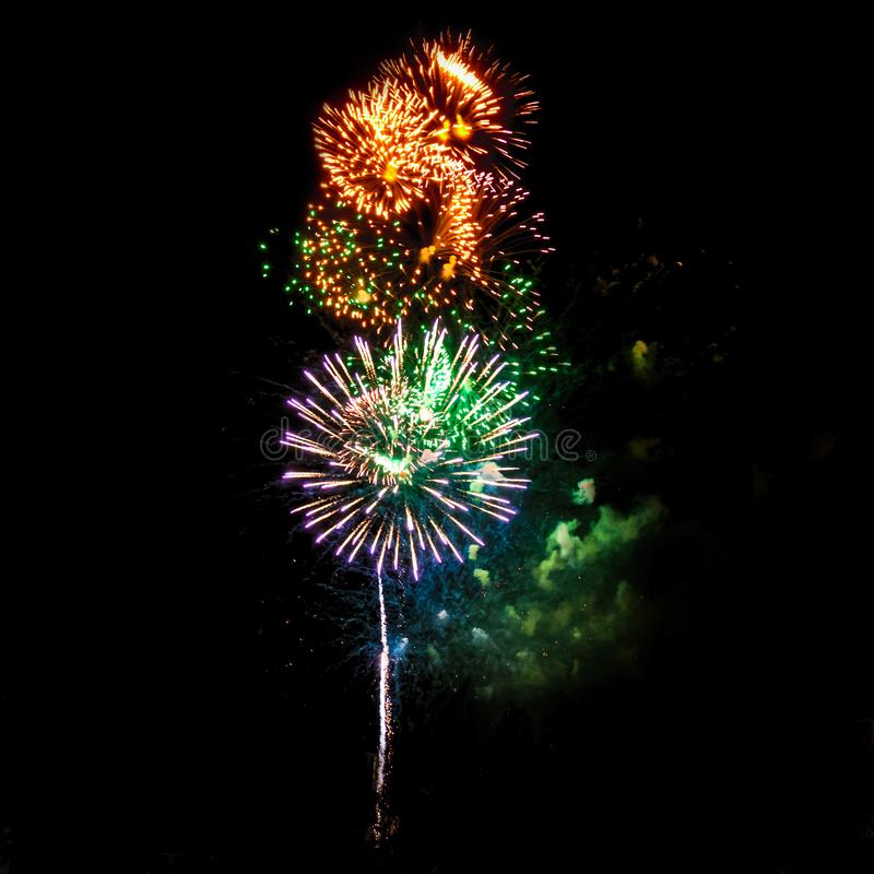 Fireworks. In the night sky. Colored lights on a black background. Celebration and joy. New year's . The fire show stock photography