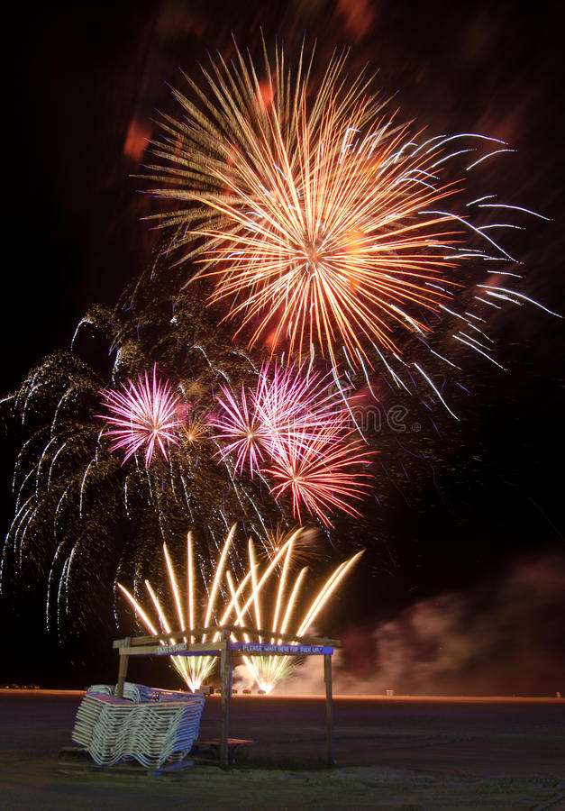 Fireworks over a beach royalty free stock image