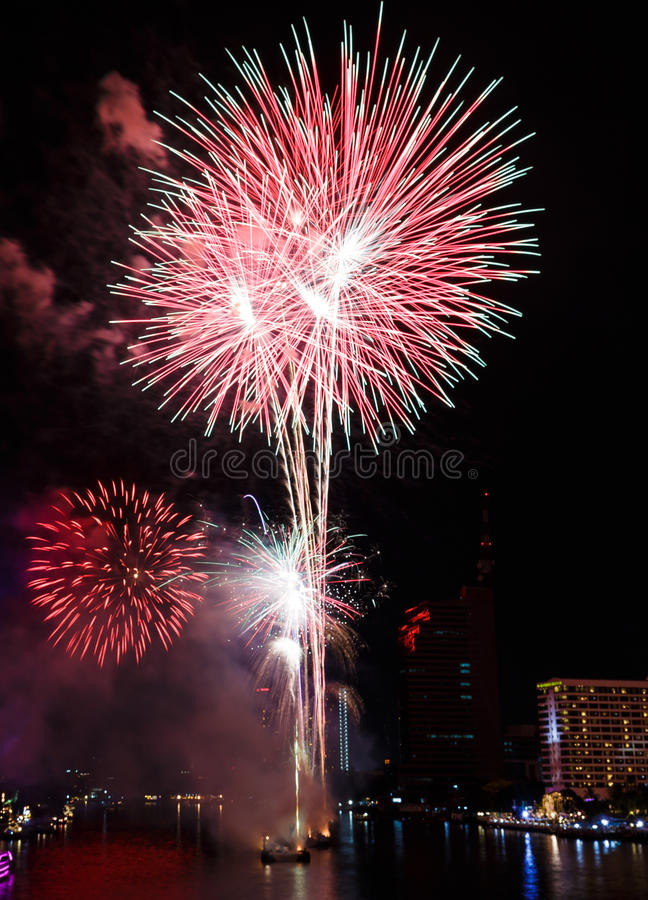 Fireworks over Chaopraya river near hotel in Bangkok Thailand stock image