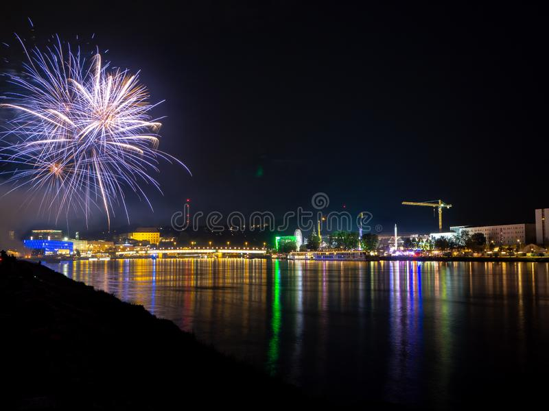 Fireworks over a city at night stock image