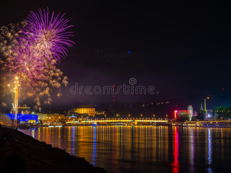 Fireworks over a city at night stock photography