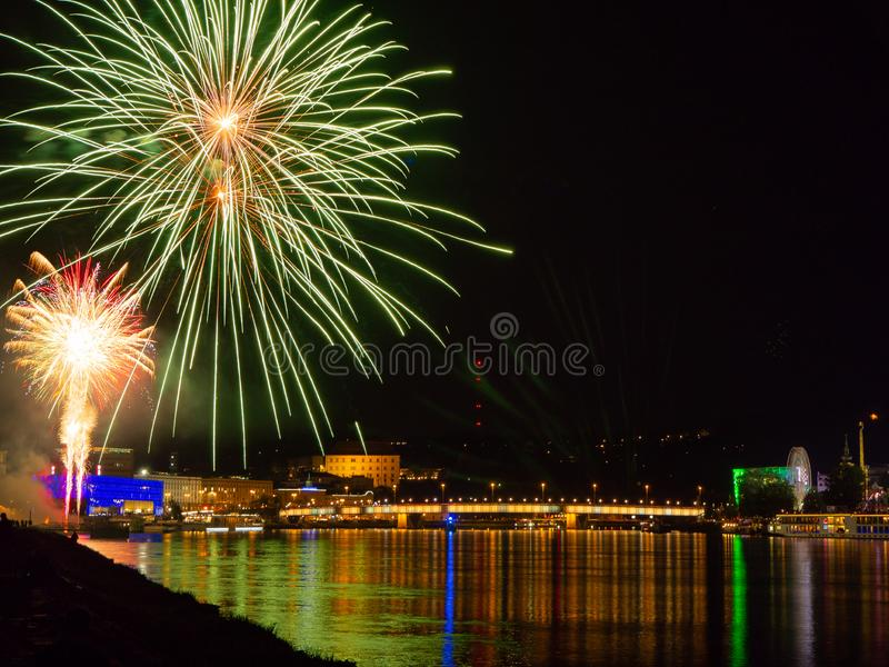 Fireworks over a city at night royalty free stock image
