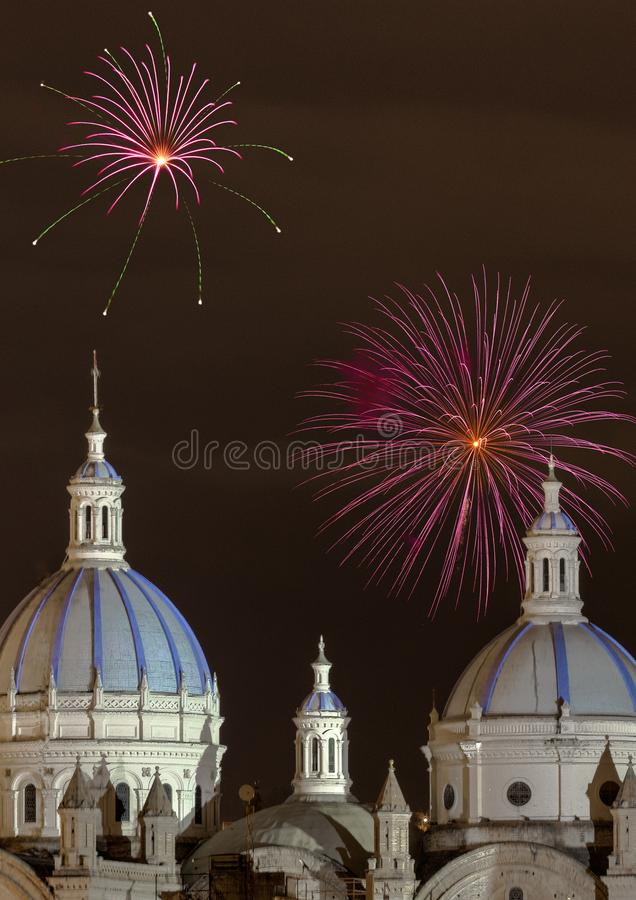Fireworks over the domes of the New Cathedral in Cuenca, Ecuador stock photo