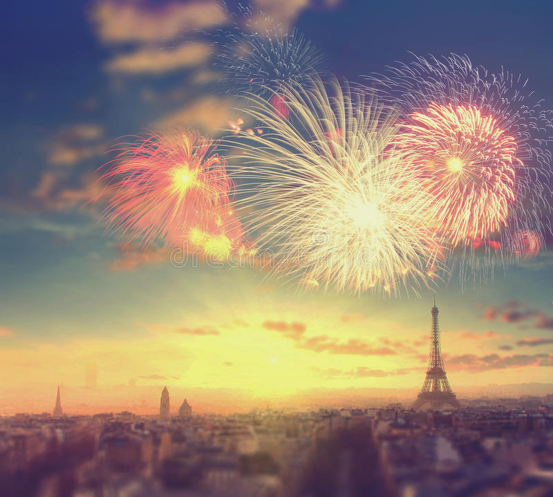 Fireworks over Eiffel tower in Paris, France. Abstract travel background: fireworks over Eiffel tower in Paris, France. Vintage colored picture royalty free stock photo