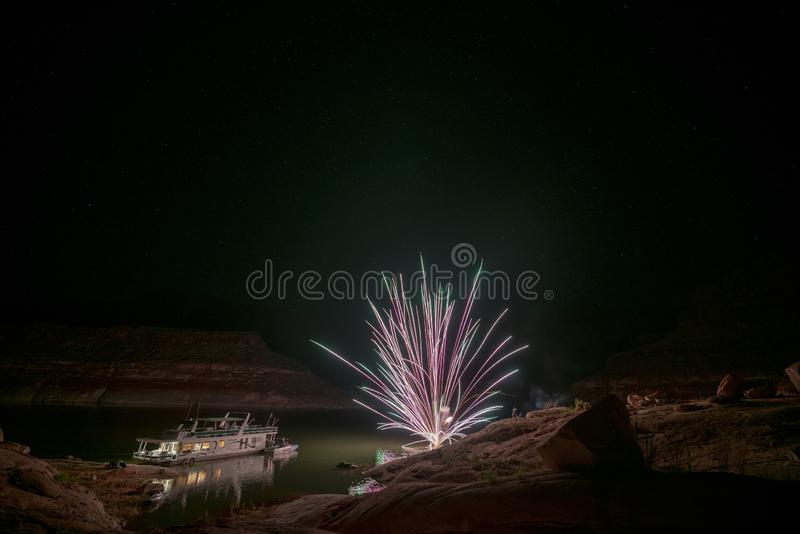 Fireworks over house boat. In the sandstone mountains of lake Powell area royalty free stock image
