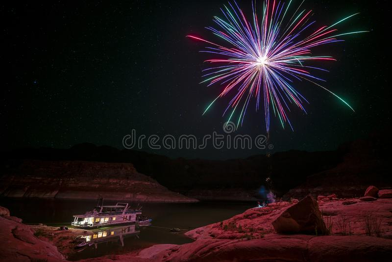 Fireworks over house boat. In the sandstone mountains of lake Powell area stock image