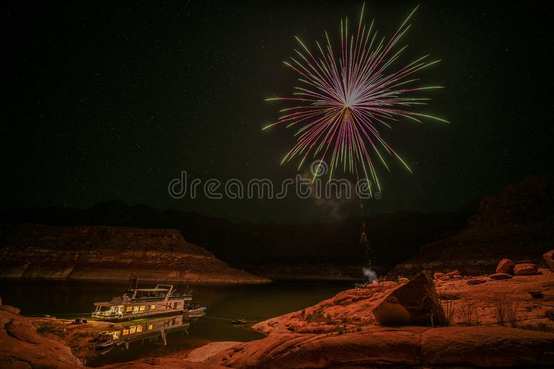 Fireworks over house boat. In the sandstone mountains of lake Powell area royalty free stock photos