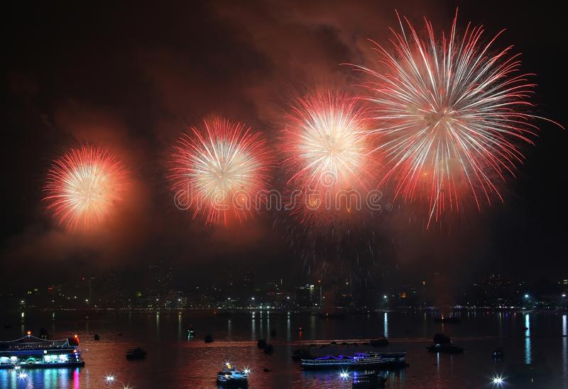 Fireworks over Lake in pattaya thailand.  royalty free stock photo