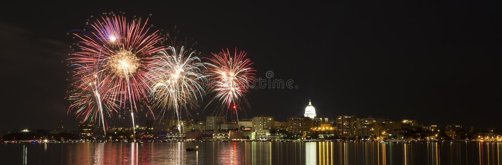 Fireworks over Madison, Wisconsin state capital and Lake Monona stock image