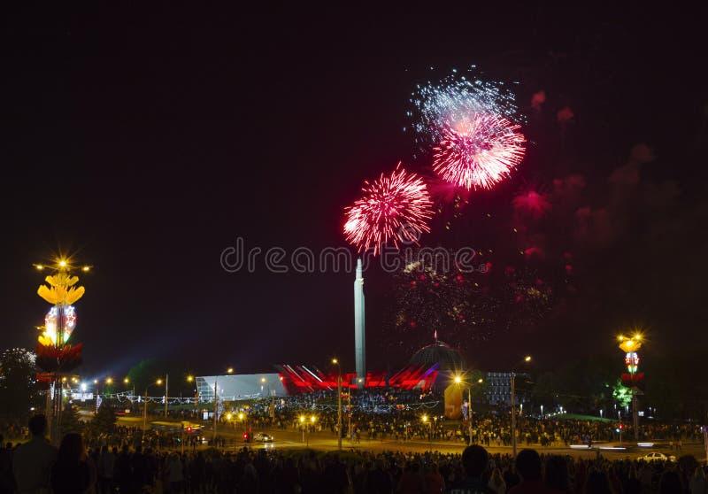 Fireworks over Minsk, Belarus. Minsk, Belarus - May 9, 2014: Victory Day fireworks and celebrations near obelisk Stella Minsk City-Hero royalty free stock photography