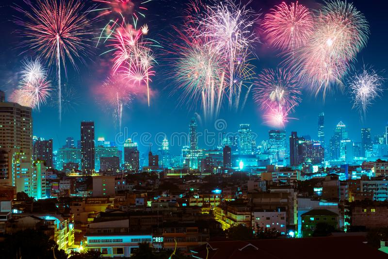 Fireworks over night city for happy new year celebration royalty free stock images