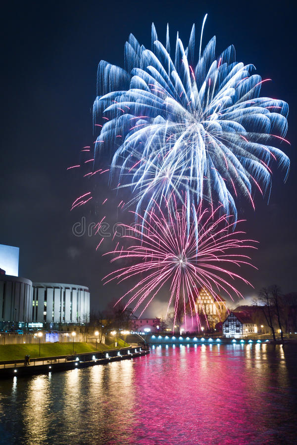 Fireworks over the river in the city stock images