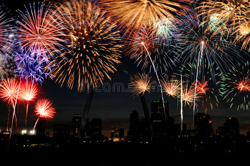 Fireworks over Saint Louis. Fireworks of multiple colors over Saint Louis with the arch and skyline stock photography