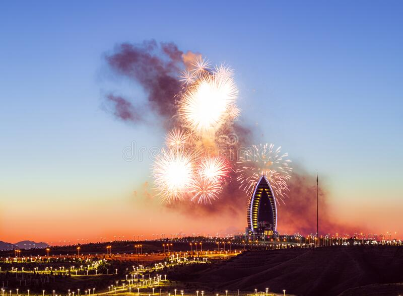 Fireworks over the 5-star hotel during the sunset in Ashgabat, Turkmenistan. Fireworks over the 5-star hotel during the sunset in Ashgabat, Turkmenistan royalty free stock photography