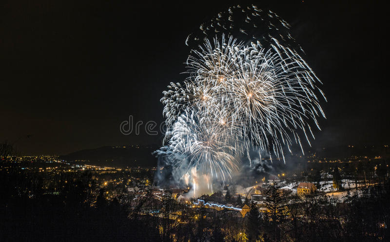 Fireworks over town stock photography