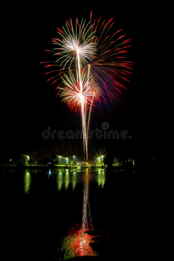 Fireworks Over The Water Stock Images