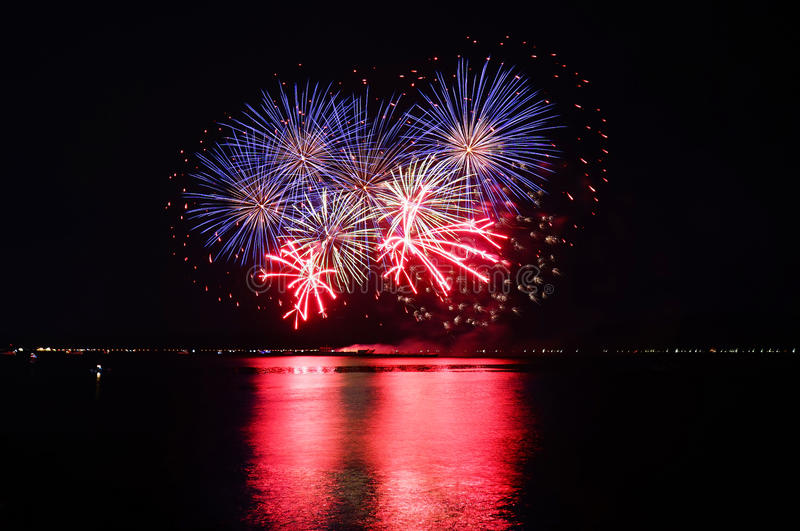 Fireworks over water royalty free stock image