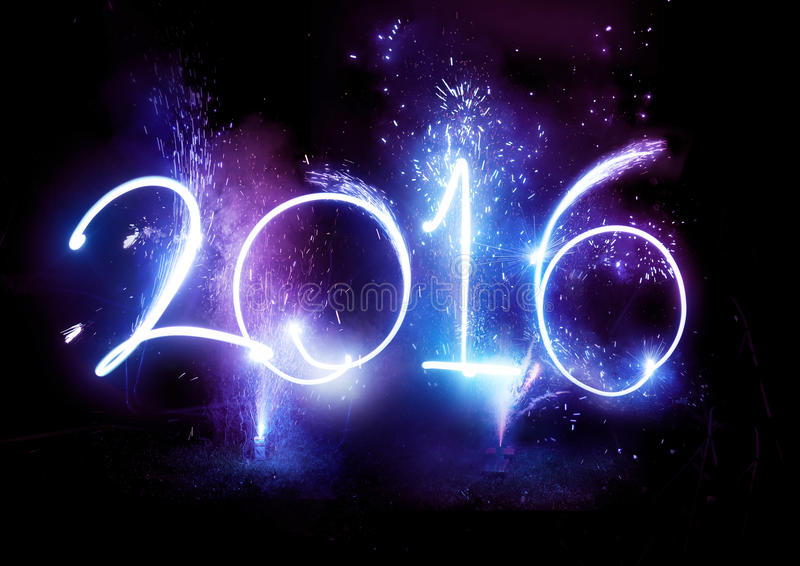 2016 Fireworks party - New Year Display!. 2016 Fireworks party - Happy New Year Display celebrations!2016 written in lights trails and fireworks stock image