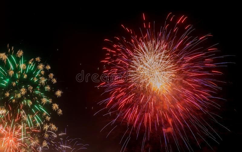 Fireworks red fireworks happiness concept. Fireworks red fireworks happiness at night for celebration, new, year, merry, christmas, wedding, day, xmas, birthday stock image