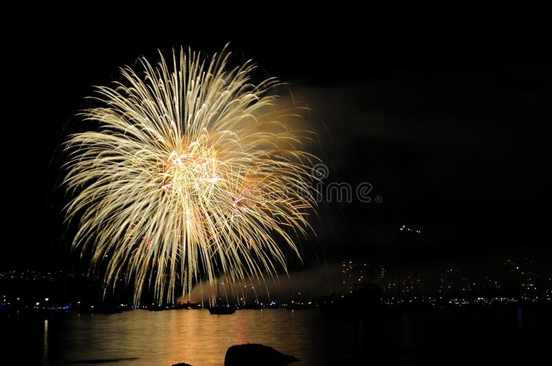 Fireworks reflecting on the water stock photos