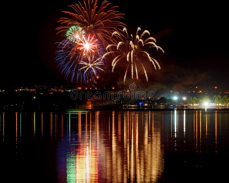 Fireworks with reflection in water royalty free stock image