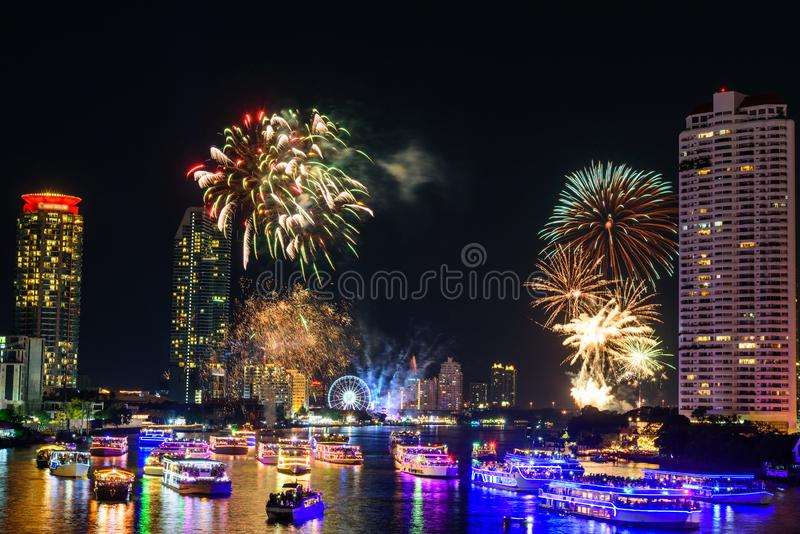 Fireworks at the river of city. In New Year countdown time royalty free stock photo