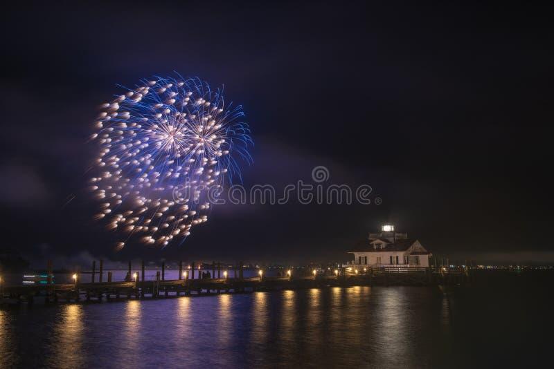 Fireworks Roanoke Marshes Lighthouse Manteo North Carolina. Fireworks over the Roanoke Marshes Lighthouse light up Shallowbag Bay in Manteo, North Carolina on stock image