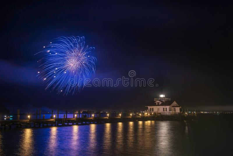 Fireworks Roanoke Marshes Lighthouse Manteo North Carolina. Fireworks over the Roanoke Marshes Lighthouse on Shallowbag Bay in Manteo, North Carolina on the royalty free stock photography