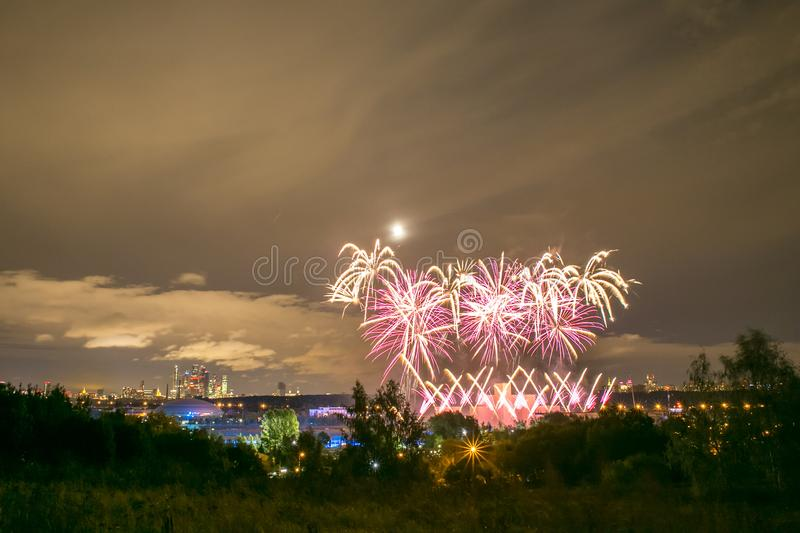 Fireworks on the rowing channel in Krylatskoye. Moscow, Russia - Serntabr 25, 2018: Colorful huge fireworks on the rowing canal in Krylatskoe from Japanese royalty free stock photo