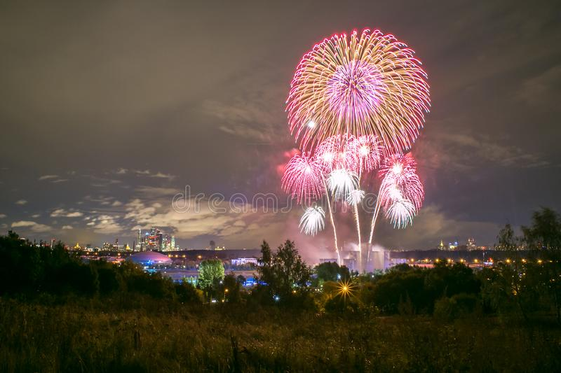 Fireworks on the rowing channel in Krylatskoye. Moscow, Russia - Serntabr 25, 2018: Colorful huge fireworks on the rowing canal in Krylatskoe from Japanese stock photos