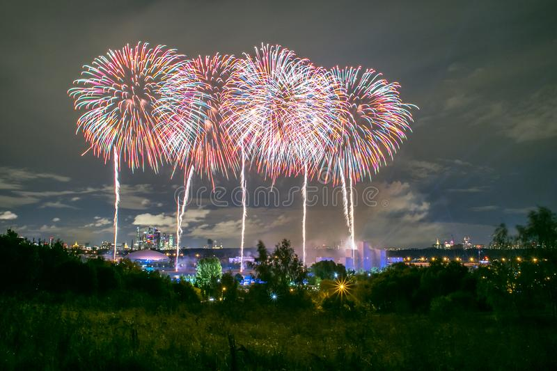 Fireworks on the rowing channel in Krylatskoye. Moscow, Russia - Serntabr 25, 2018: Colorful huge fireworks on the rowing canal in Krylatskoe from Japanese stock images