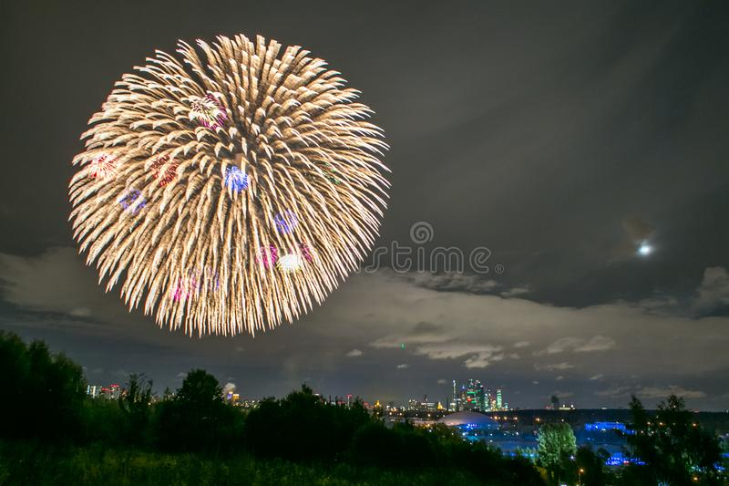 Fireworks on the rowing channel in Krylatskoye. Moscow, Russia - Serntabr 25, 2018: Colorful huge fireworks on the rowing canal in Krylatskoe from Japanese stock image