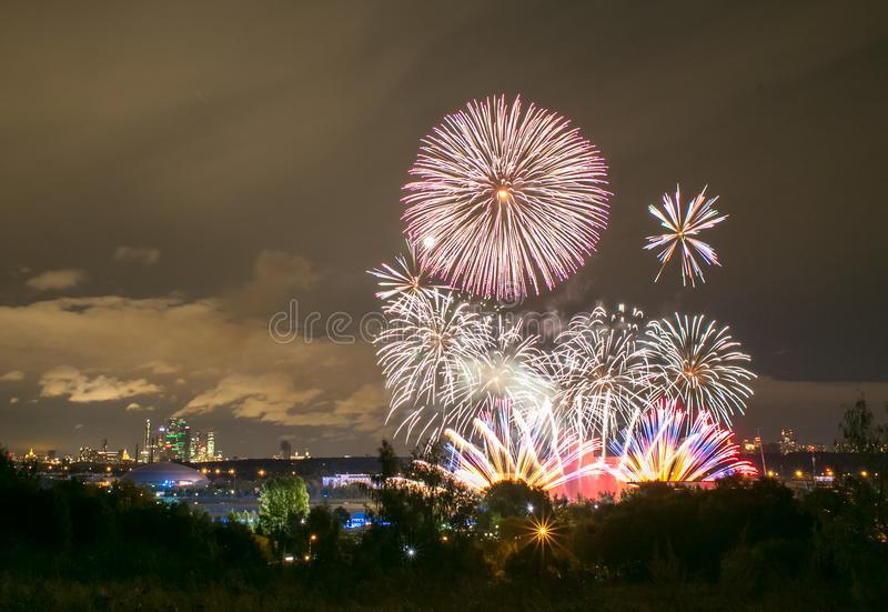 Fireworks on the rowing channel in Krylatskoye. Moscow, Russia - Serntabr 25, 2018: Colorful huge fireworks on the rowing canal in Krylatskoe from Japanese royalty free stock photos