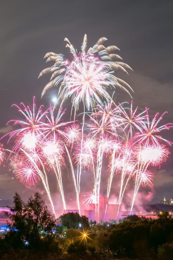 Fireworks on the rowing channel in Krylatskoye. Moscow, Russia - Serntabr 25, 2018: Colorful huge fireworks on the rowing canal in Krylatskoe from Japanese stock photography