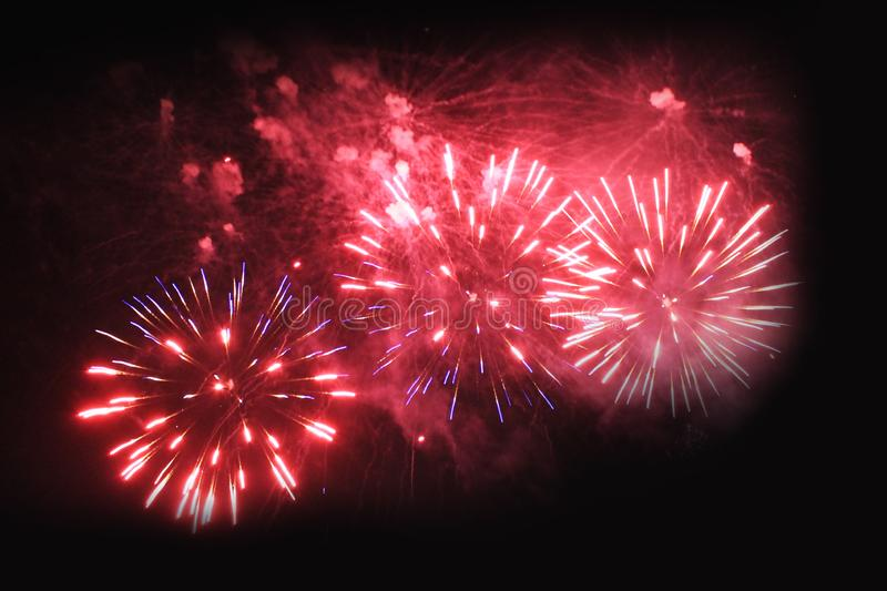 Fireworks. Salute. Sky background Amazing mystery of bright pink sparkling lights in the night sky during the New Year and. Christmas holidays royalty free stock image