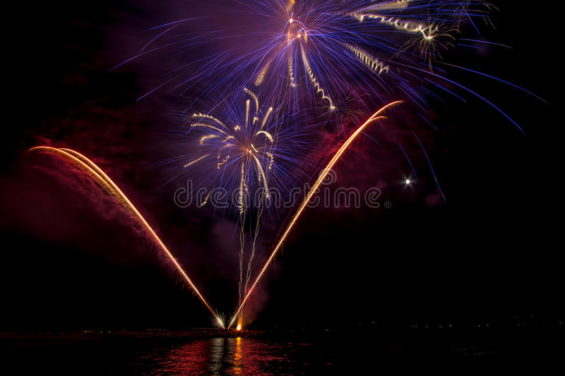 Fireworks on sea. Fireworks in water on sea near Follonica, Italy royalty free stock image