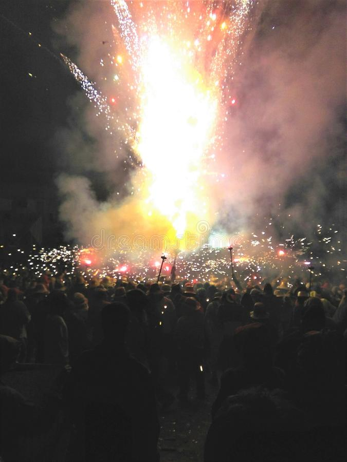 Fireworks show at midnight with people dancing around it royalty free stock photography